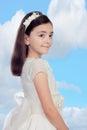 Petite fille adorable habillée dans la communion Photographie stock