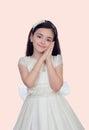 Petite fille adorable habillée dans la communion Images stock