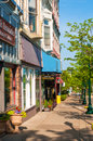 Petoskey businesses mi june shops and along mitchell street observer facing west in s quaint gaslight district awaken to Royalty Free Stock Photography