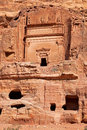 Petra a view of one of the ancient buildings carved into the stone in the rose city of jordan Royalty Free Stock Image