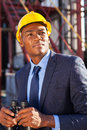 Petrochemical businessman binoculars handsome afro american with at plant Royalty Free Stock Image