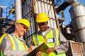 Petrochemical co workers working at refinery plant Stock Photography