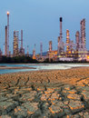 Petrochemical plant at sunset time enviromental effect with Stock Images
