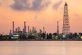 Petrol chemical refinery industry plant waterfront, dramatic sky during sunrise Royalty Free Stock Photo