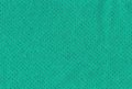 Petrol green fabric coloured texture with golden dots on Royalty Free Stock Image