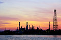 Petroleum oil refinery factory over sunrise Royalty Free Stock Image
