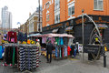 Petticoat lane market london united kingdom november london on november with clothing stalls at sunday in Royalty Free Stock Photography