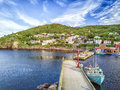 Petty Harbour with two piers during summer sunset, Newfoundland, Royalty Free Stock Photo