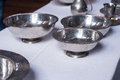 Pewter dinner service set on table bowls plates and jugs Royalty Free Stock Photos