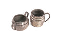 Pewter sugar bowl and milk jug on a white background Stock Photography