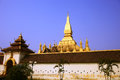 Pha that luang lao temple behind the wall Stock Photo