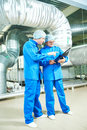 Pharmaceutical male workers in water preparation production line Royalty Free Stock Photo