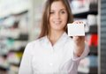 Pharmacist advising prescribed medicine female to prefer Royalty Free Stock Photo