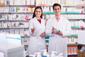 Pharmacist and pharmacy technician working positive posing in drugstore Royalty Free Stock Images