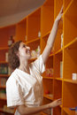 Pharmacist reaching for medicine Royalty Free Stock Image