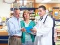 Pharmacist with a senior couple. Royalty Free Stock Photo
