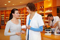 Pharmacist talking to woman Royalty Free Stock Photos