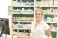 Pharmacist worker in drug store Stock Images