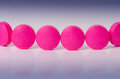 Pharmacy background. queue of pink pills. Reflection of drug. Pharmaceutical Royalty Free Stock Photo