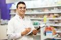 Pharmacy chemist woman in drugstore cheerful pharmacist standing Stock Photos