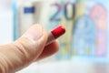 Man take expensive pill,  antibiotics and money Royalty Free Stock Photo