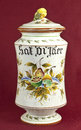 Pharmacy jar bis old decorated on oxblood red background Stock Images