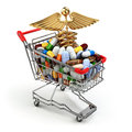 Pharmacy medicine concept. Shopping cart with pills and caduceus Royalty Free Stock Photo