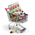 Pharmacy medicine concept. Shopping cart with pills and capsules Royalty Free Stock Photo