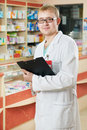 Pharmacy specialist in drugstore Stock Photo