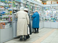 In a pharmacy three old ladies choose medications Stock Images