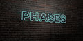 PHASES -Realistic Neon Sign on Brick Wall background - 3D rendered royalty free stock image