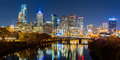 Philadelphia cityscape panorama by night schuylkill river reflects the colorful skyscrapers Stock Photos