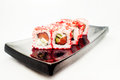 Philadelphia Maki Sushi - Roll with smoked salmon, cream cheese, shrimp, cucumber inside. Royalty Free Stock Photo