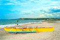 Philippines beach with beautiful sky fisherman boat on a and village on a background Royalty Free Stock Images
