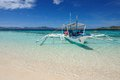 Philippines boat in crystal clear water Stock Images