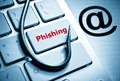 Phishing a fish hook on computer keyboard computer crime data theft cyber crime Stock Photos