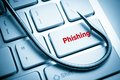 Phishing a fish hook on computer keyboard computer crime data theft cyber crime Stock Photography