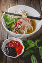 Pho Vietnamse Noodle Soup on Old Wood. Image for Food Advertise Royalty Free Stock Photo