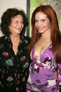 Phoebe price and her mother at champagne and bikinis hosted by geoff thomas designs and featuring his metallic bikinis geoff Stock Image