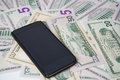 Phone on a background of money Royalty Free Stock Photo