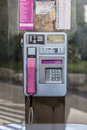 Phone booth an old in croatia with aluminium dial and pink receiver Stock Photo