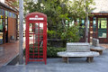 Phone booth and wooden chair Royalty Free Stock Photo