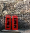 Phone booths three red on a row in the street at edinburgh scotland uk Stock Photo
