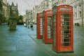 Phone booths three red on a row in the street at edinburgh scotland uk vintage and retro style Stock Photography