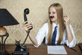 Phone call leads to anger business woman Stock Images