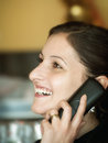 Phone conversation beutiful woman having a on the Royalty Free Stock Photography