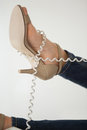 Phone cord wrapped around womans foot Royalty Free Stock Photo