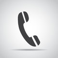 Phone icon with shadow on a gray background. Vector illustration