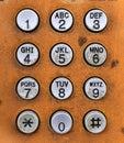 Phone keypad close up shot of orange and white Stock Photos