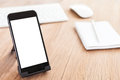 Phone mobile blank white screen on holder Royalty Free Stock Photo